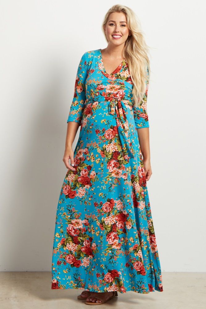 A floral print maxi dress. V-neckline. Perfect for nursing after pregnancy. Cinched under bust. Sash tie. 3/4 sleeves.