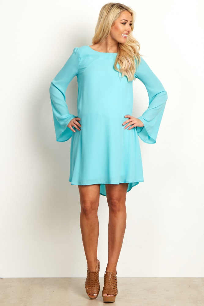 A solid chiffon maternity dress. Rounded neckline. Bell sleeves. Double lined to prevent sheerness.