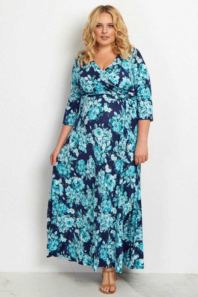 A floral printed plus size maxi dress. V-neckline. Cinched under bust. Sash tie. 3/4 sleeves.