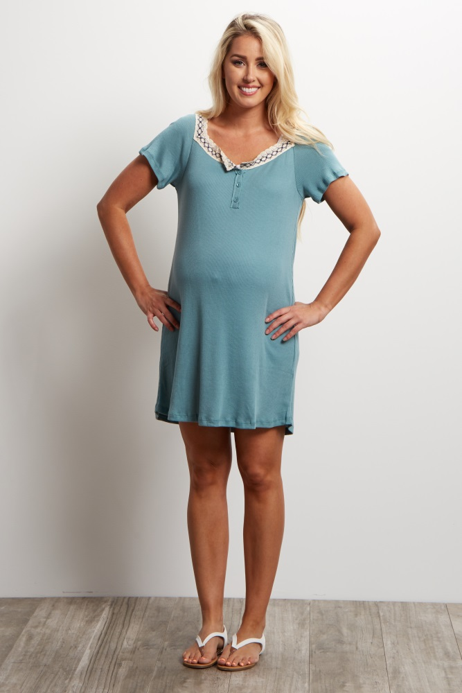 A ribbed short sleeve tunic. Rounded crochet neckline detail. Button front closure.
