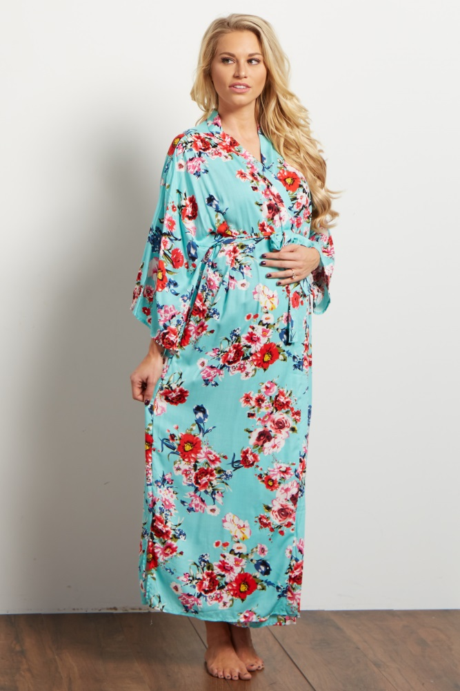 A floral printed long dressing robe. Open front with tie closure.