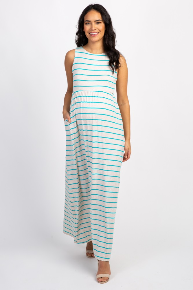 Striped sleeveless maxi dress. Rounded neckline. Top double lined to prevent sheerness.