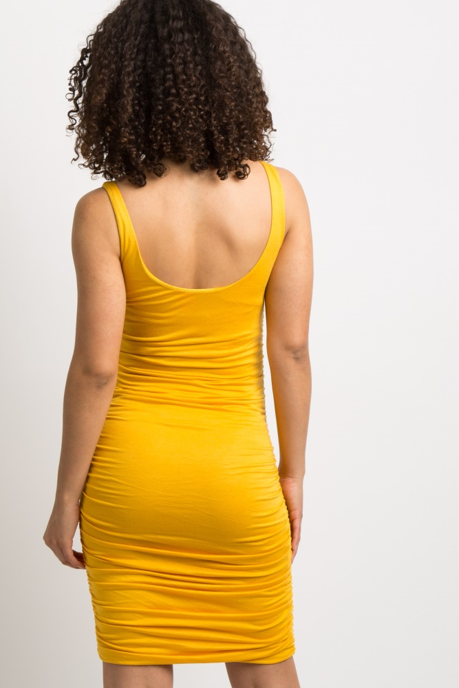 0c527db9aba Yellow Solid Ruched Maternity Dress