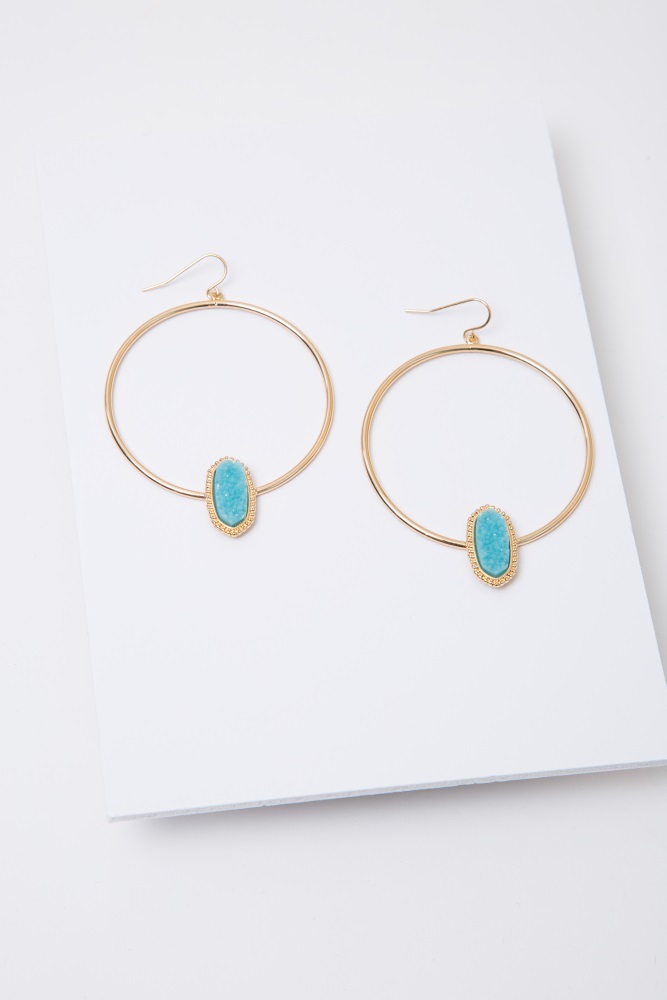 Gold hoop earrings with a faux geode accent and a fish hook back.
