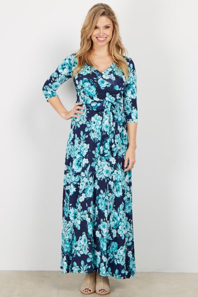 A floral printed maxi dress. V-neckline. Perfect for nursing after pregnancy. Cinched under bust. Sash tie. 3/4 sleeves.