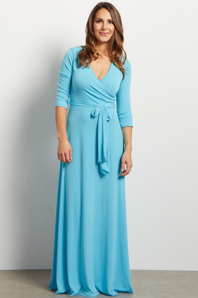 A solid maxi dress. Draped v-neckline. Cinched under bust. Sash tie. 3/4 sleeves.