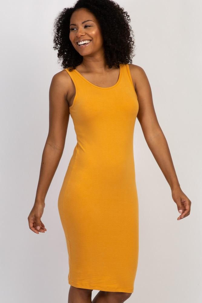 yellow sleeveless fitted dress